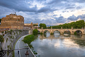 Rome and Tiber river with high water in February and flag of Italy