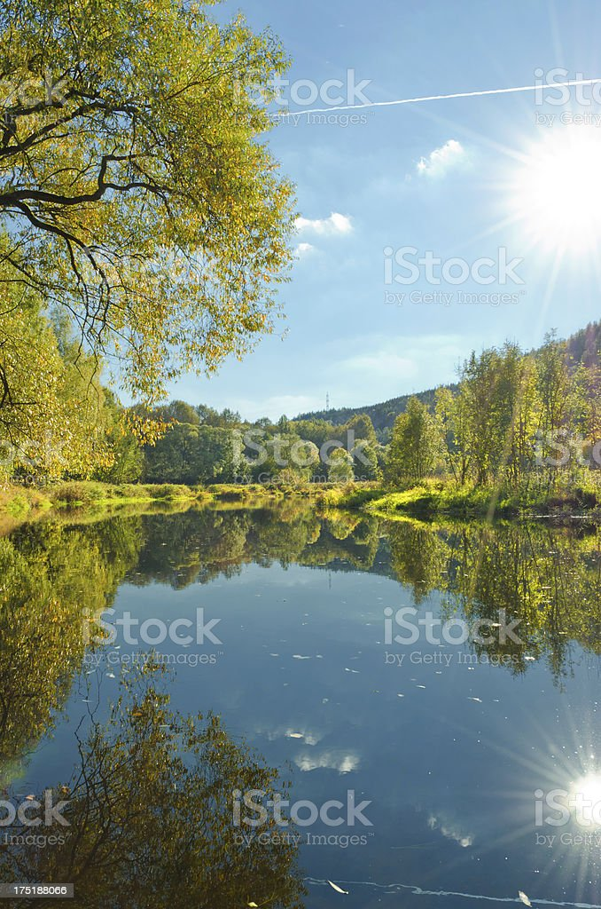 cloudy sky over a river in autumn stock photo