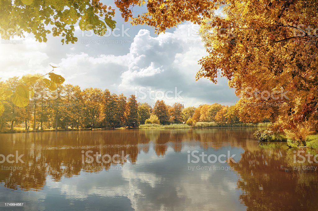cloudy sky over a village pond in autumn stock photo