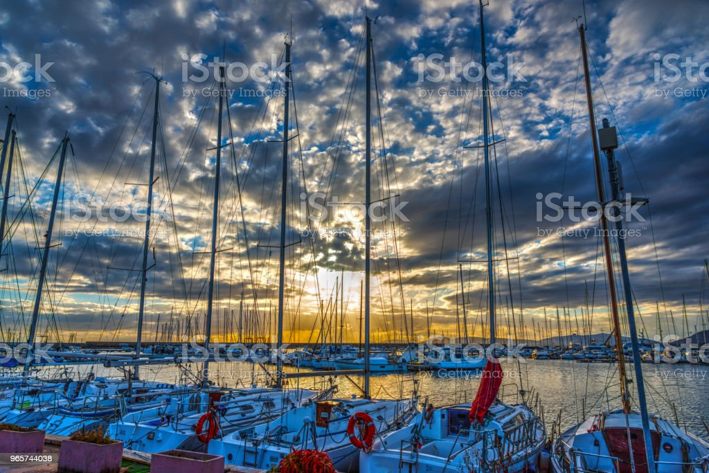 Cloudy sky over Alghero harbor at sunset - Royalty-free Alghero Stock Photo