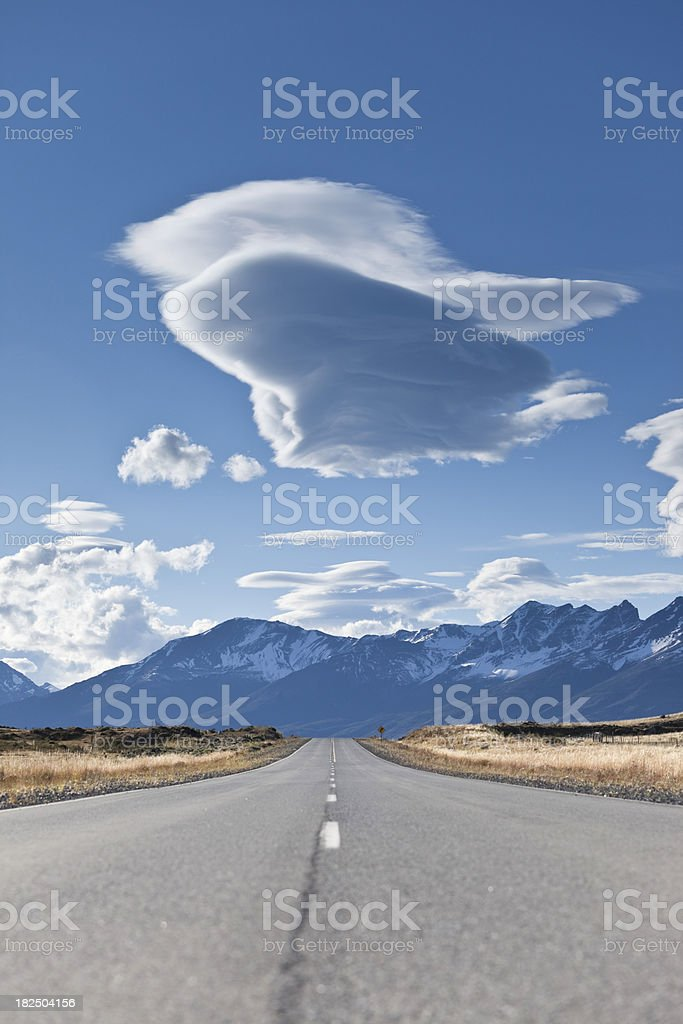 Cloudy sky over empty highway in Argentina Patagonia royalty-free stock photo