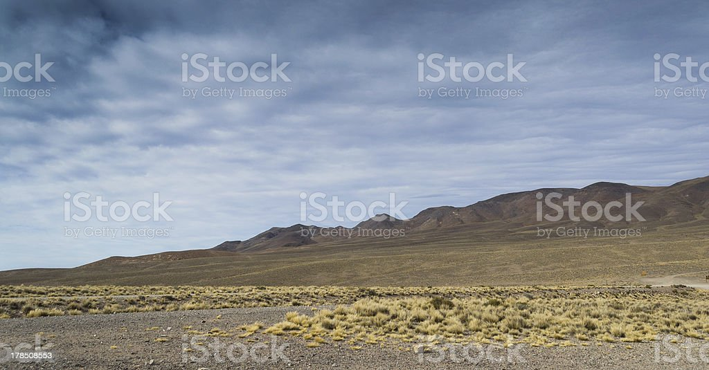 Cloudy sky over plains and mountains royalty-free stock photo