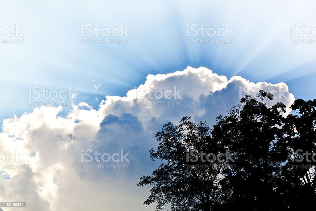 cloudy sky with rays of the sun stock photo