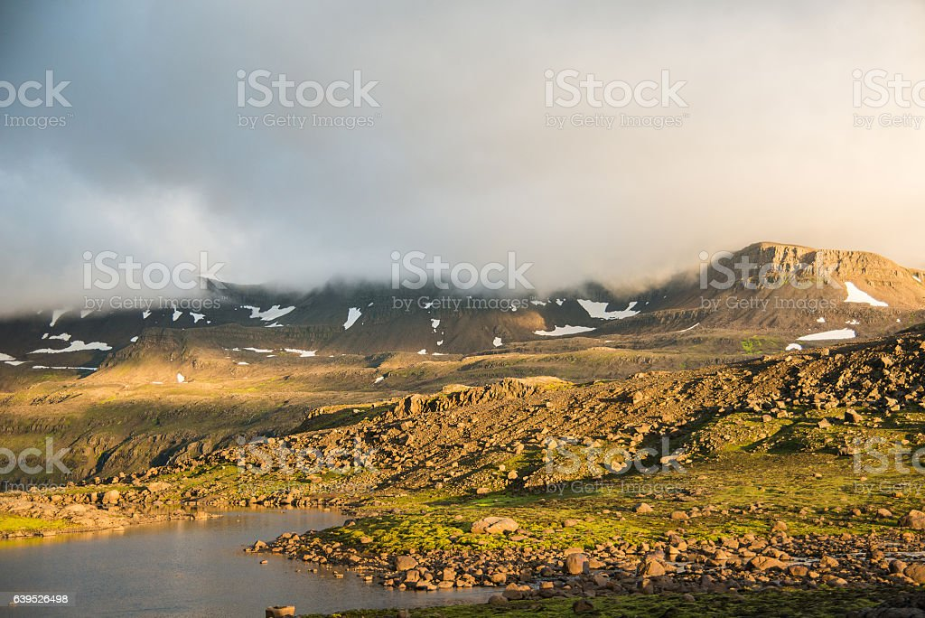 cloudy sunny rocky landscape in iceland stock photo