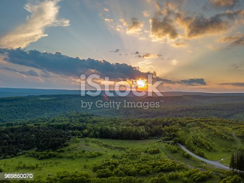 Bright colorful sunset over forest from high up