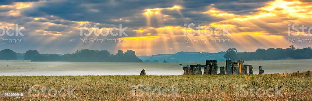 Cloudy sunrise over Stonehenge stock photo