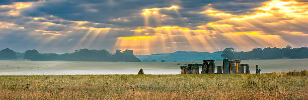 Cloudy sunrise over Stonehenge stock photo