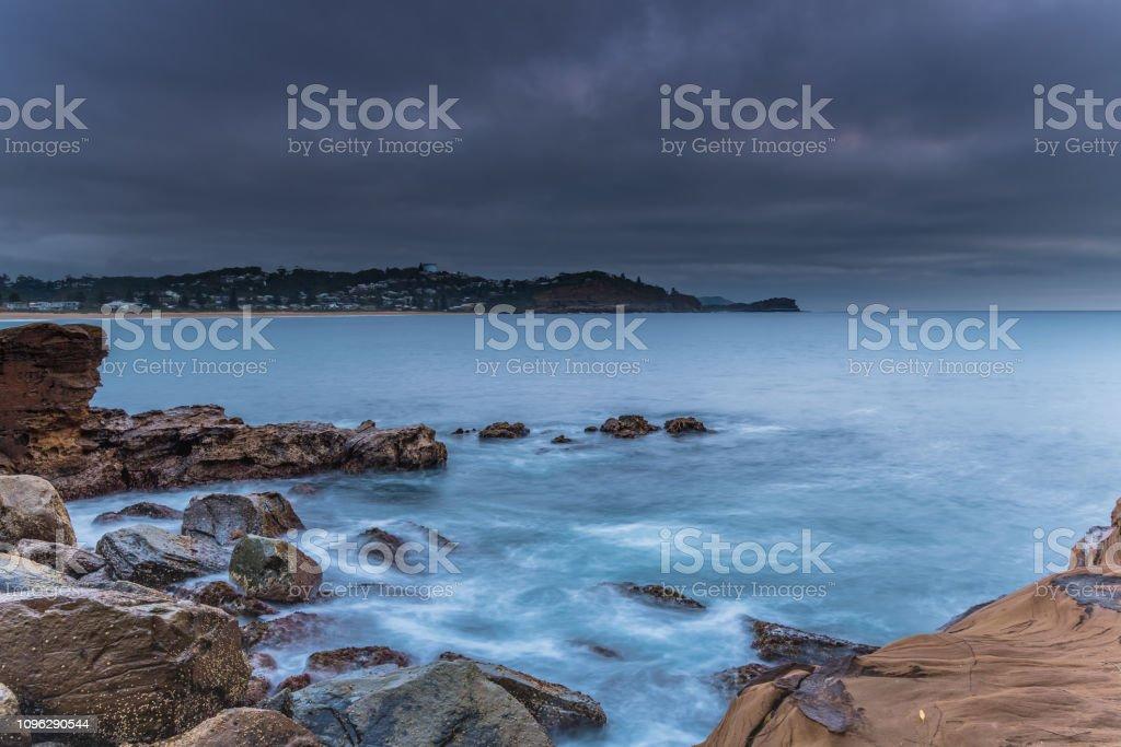 Cloudy Sunrise Seascape stock photo