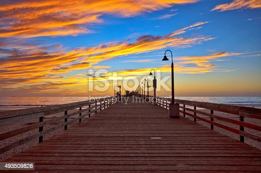 Sunset at the Imperial Beach Fishing Pier, San Diego, California. Taken 1 October 2015. Imperial Beach is the most southwesterly city in the continental United States. The 1300 foot long wooden pier is a popular place to fish and watch a sunset.