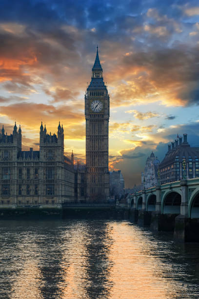 cloudy sunset behind the big ben, london - big ben stock photos and pictures