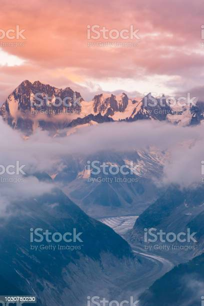 Photo of Cloudy Sunset over Iconic Mont-Blanc Mountains Range and Glaciers