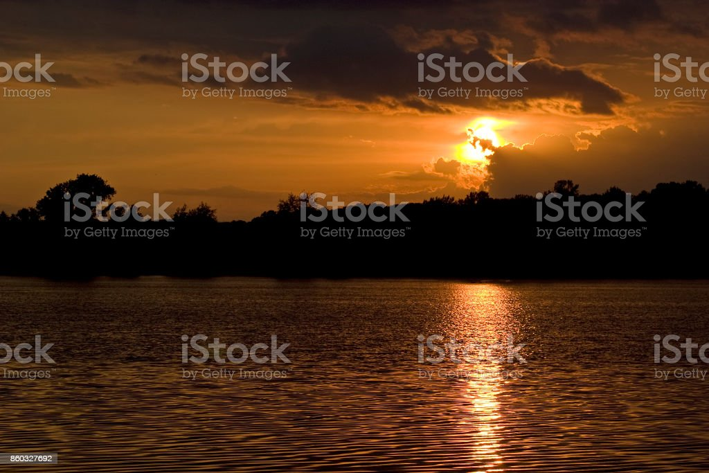 Cloudy Sunset Reflected in Lake royalty-free stock photo