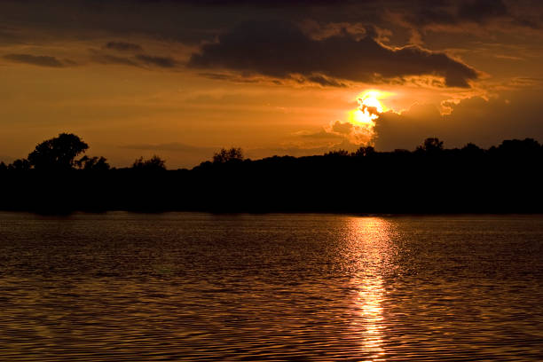 Cloudy Sunset Reflected in Lake stock photo