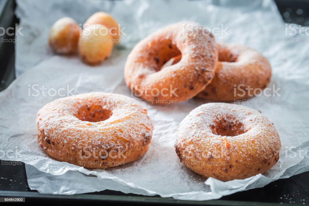Clouseup of sweet golden donuts with sugar ready to eat stock photo