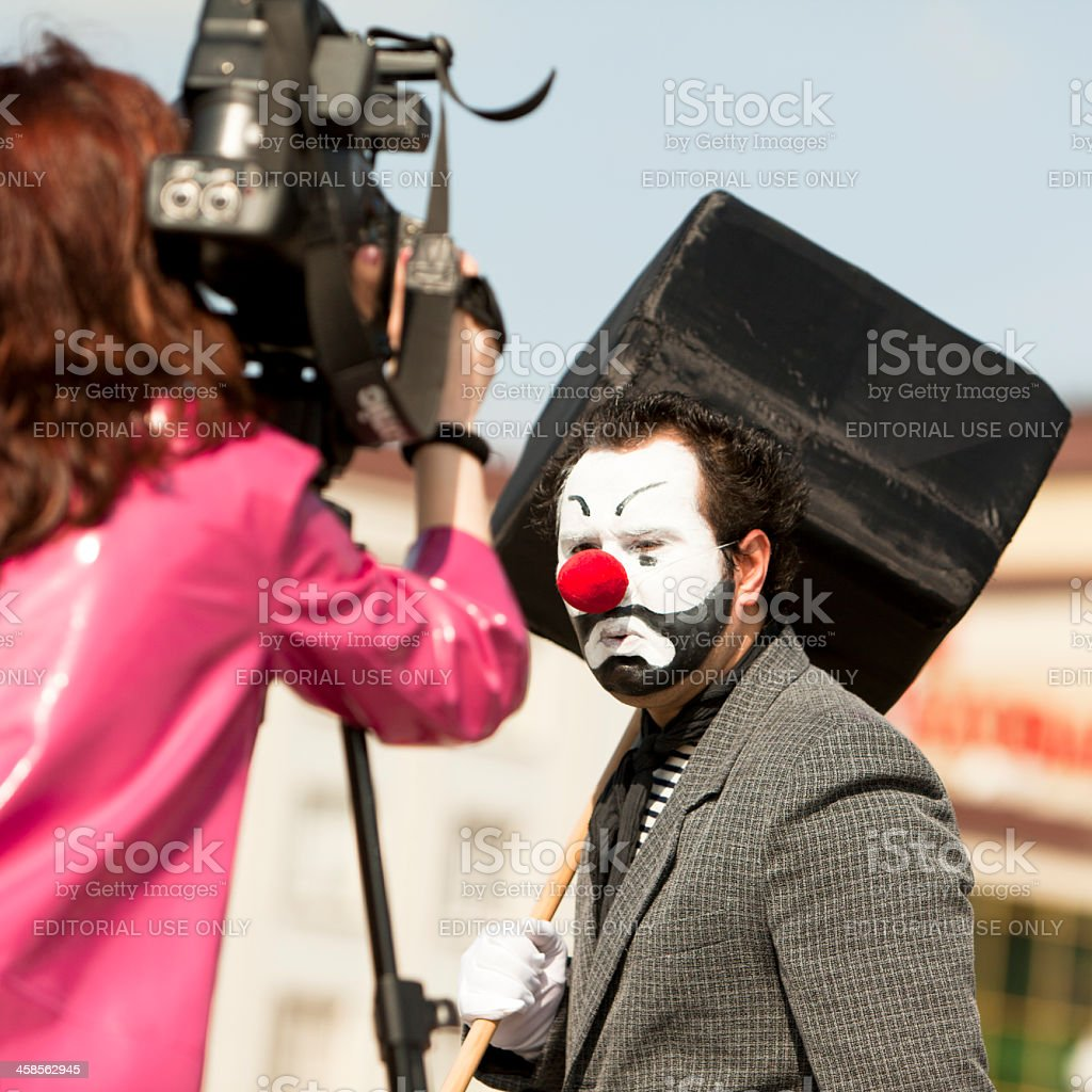 Clown and reporter royalty-free stock photo