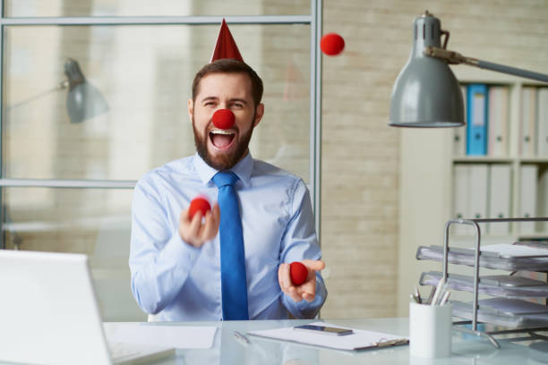 clown at office - april fools stock photos and pictures