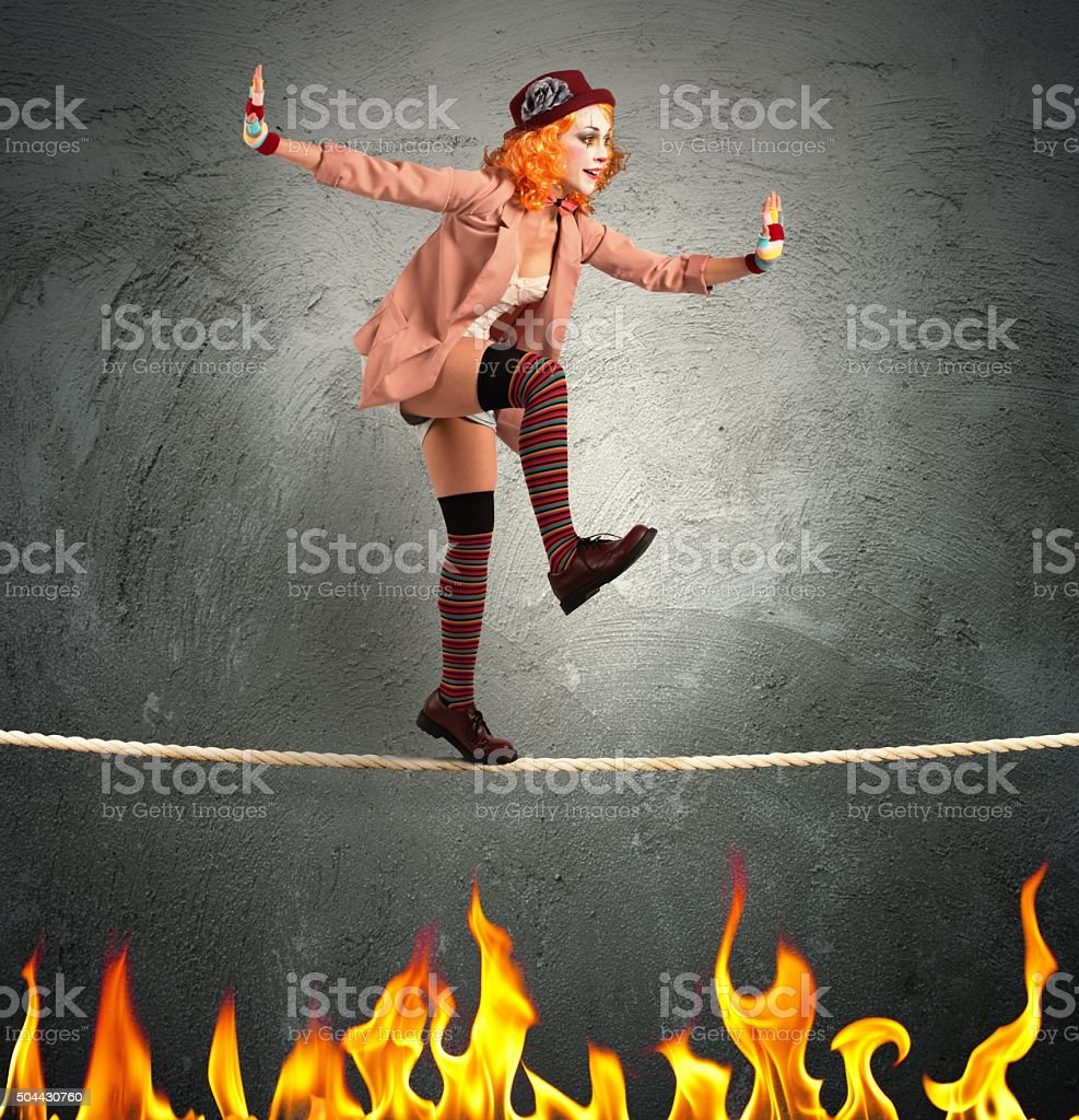 Clown balance on fire stock photo