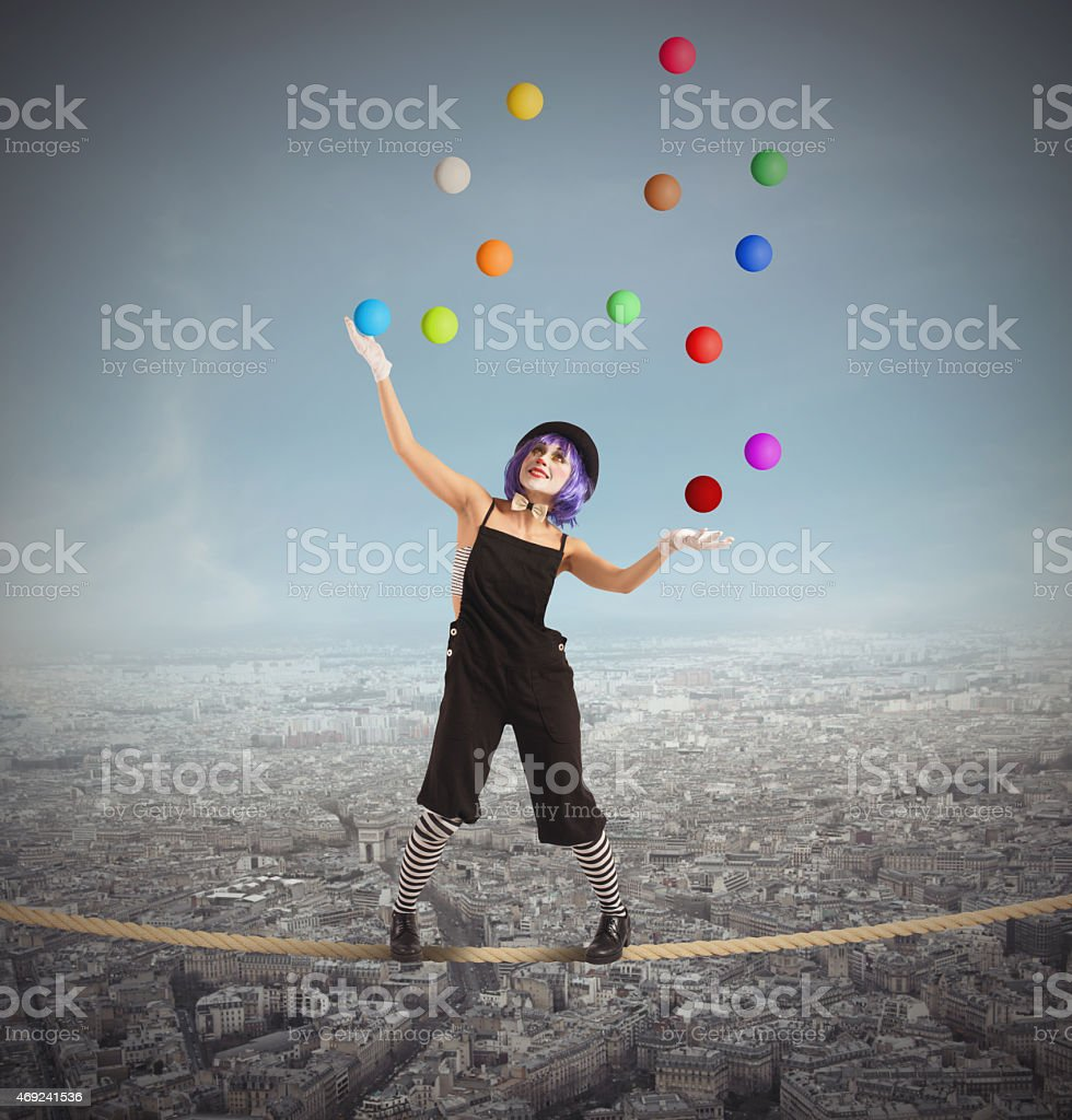 Clown difficult balance stock photo