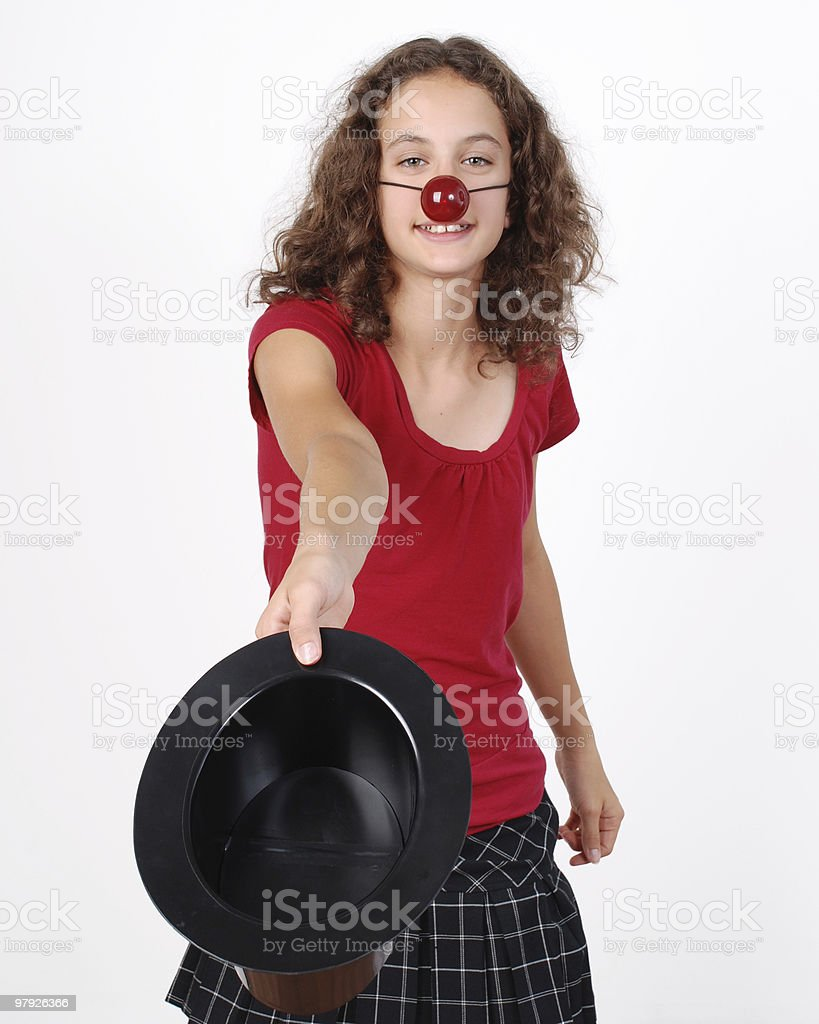 Clown Girl showing a magician hat royalty-free stock photo