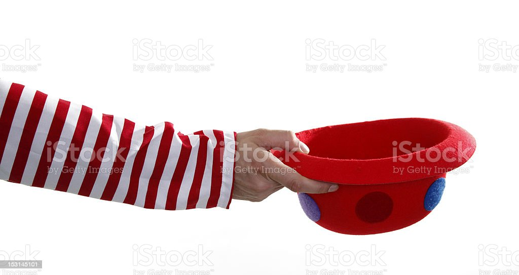 Clown hand is begging money with funny hat stock photo