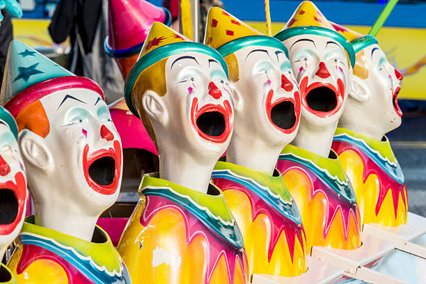 Clown Heads in a Row at Fun Fair​​​ foto