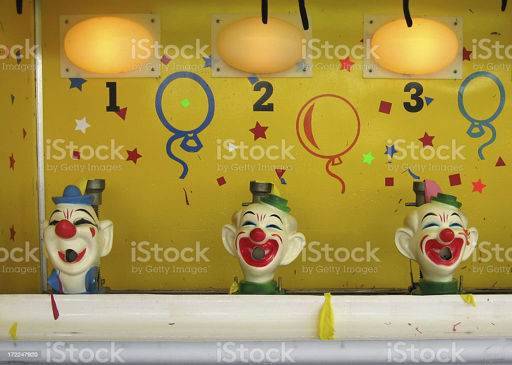 Clown Water Gun Balloon Game stock photo