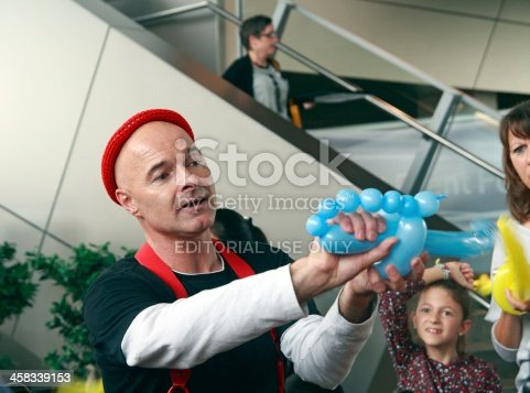 istock Clown with air balloons 458339153