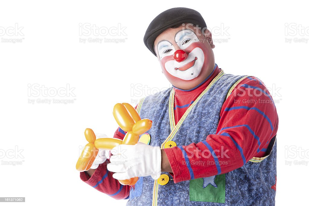 Clowns: Adult Making Balloon Animals Entertain Trick Funny Smile stock photo