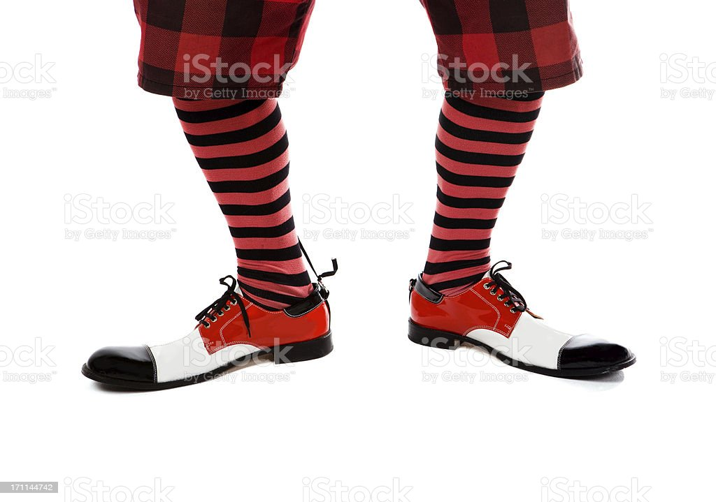 Clown's feet with funny shoes royalty-free stock photo