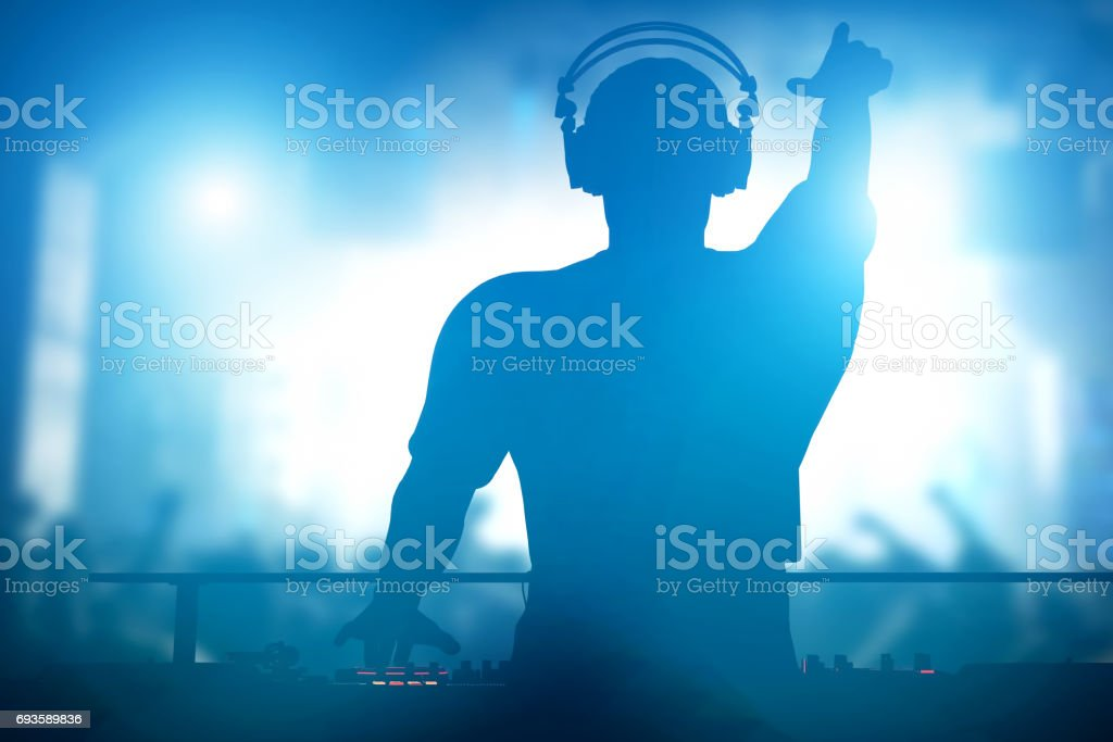 Club, disco DJ playing and mixing music for people. Nightlife stock photo