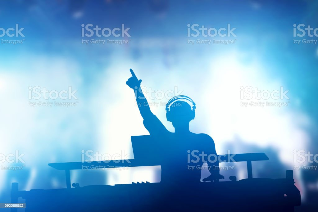 Club, disco DJ playing and mixing music for people. Nightlife royalty-free stock photo