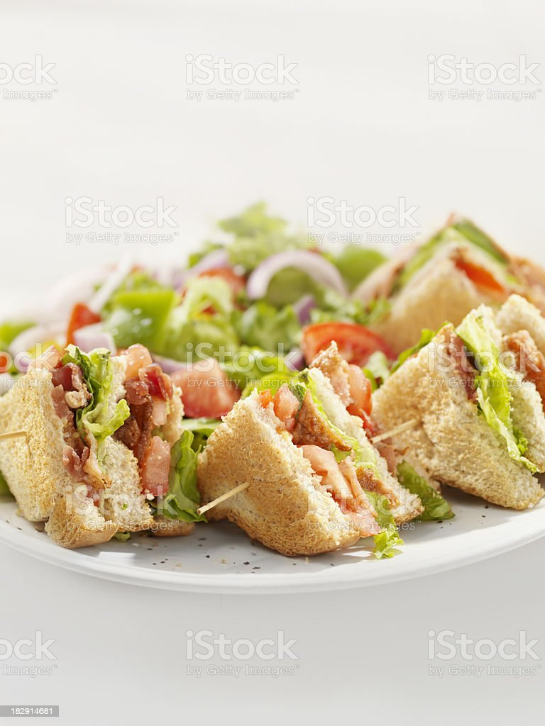 BLT Club House Sandwich with a Salad royalty-free stock photo