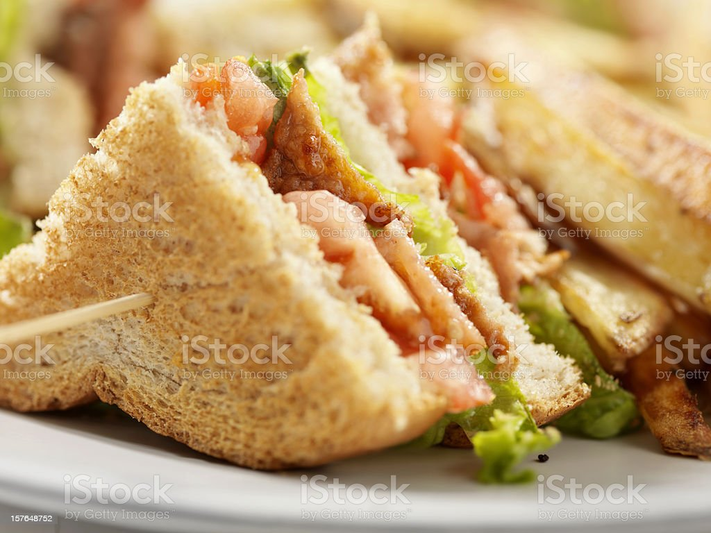 BLT Club House Sandwich with French Fries stock photo