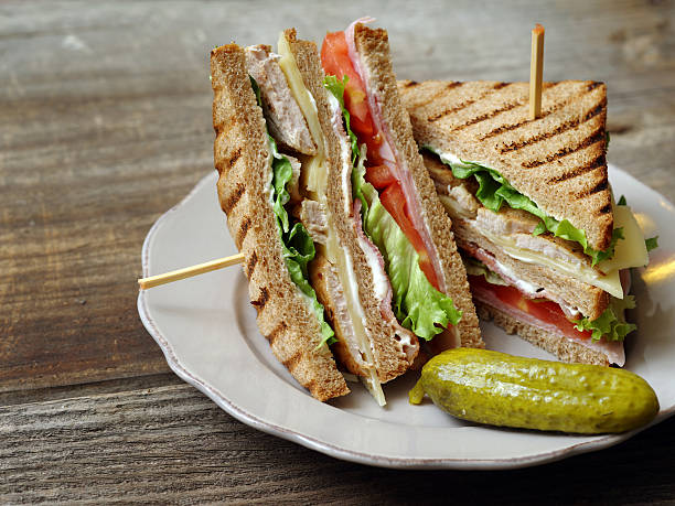 club sandwich on a plate - club sandwich stock photos and pictures
