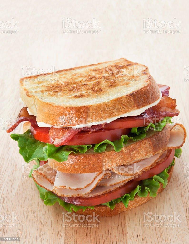 Club Sandwich On A Wooden Cutting Board. stock photo