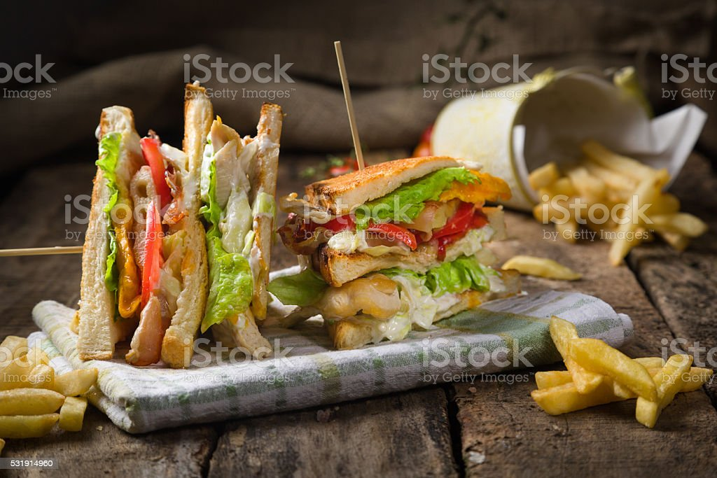 club sandwich on rustic wooden table. stock photo