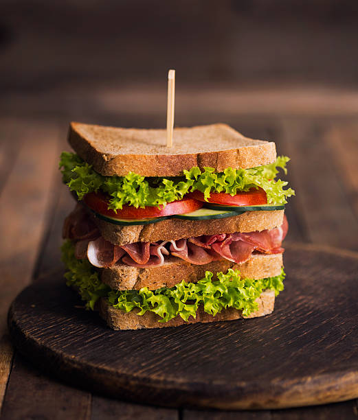 club sandwich on the table - club sandwich stock photos and pictures