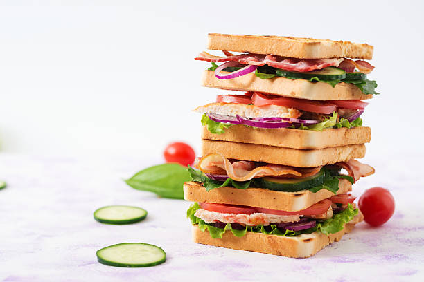 club sandwich with chicken breast, bacon, tomato, cucumber and herbs - französischer zwiebel dip stock-fotos und bilder