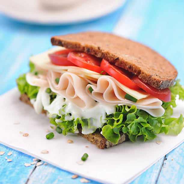 Club sandwich with chicken ham and whole wheat bread stock photo