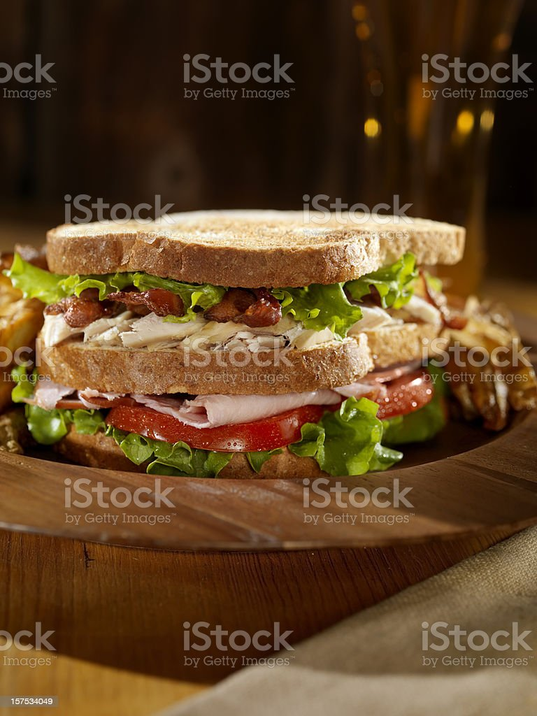 Club Sandwich with French Fries and a Beer stock photo