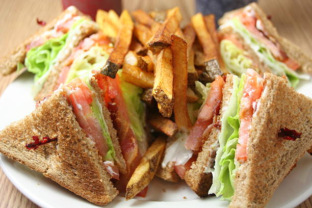 blt club sandwich with french fries - club sandwich stock photos and pictures