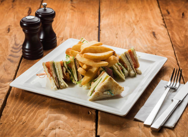 club sandwich with french fries - club sandwich stock photos and pictures