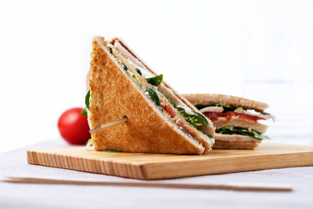 Club sandwich, with tomato, lettuce and cheese on white background - foto stock
