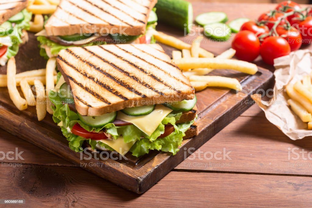 Club sandwich with tomatoes , cucumber , ham and cheese stock photo