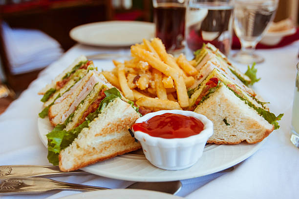 club sandwiches with french fries on side - club sandwich stock photos and pictures