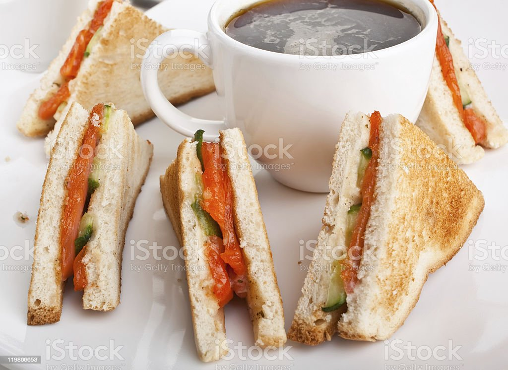 club sandwiches with salmon and cucumbers royalty-free stock photo