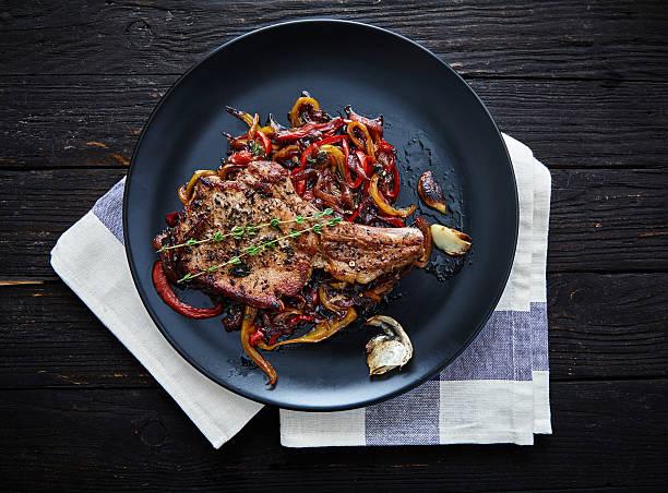 club-steak. fleisch rippen - steak anbraten stock-fotos und bilder
