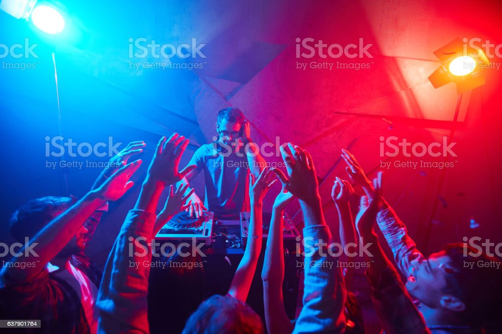 Clubbers and deejay stock photo