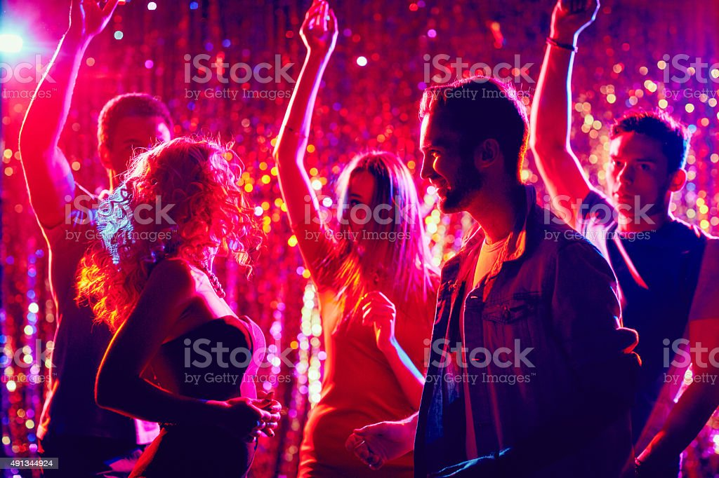 Clubbers at disco stock photo