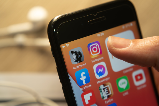 Bangkok, Thailand - February 15, 2021 : iPhone 7 showing its screen with popular social networking applications which are Clubhouse, Instagram and Facebook.